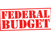 Federal%20budget%20red%20rubber%20stamp%20over%20a%20white%20background